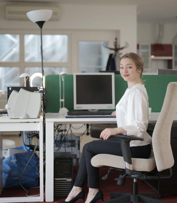 elegant-female-employee-sitting-on-chair-in-modern-workplace-3790849